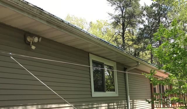 LeafGuard Aluminum Gutters Installed on a Home with a Metal Roof in Shawano, WI