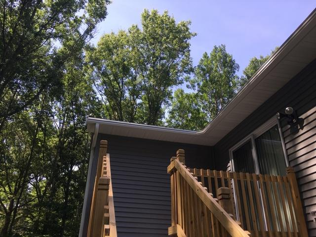 LeafGuard Gutters are the Best Choice for this Homeowner in Suamico with a Metal Roof