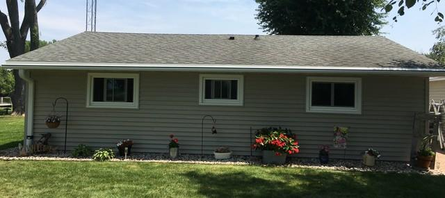 White LeafGuard Gutters Installed on a Ranch Style Home in Omro, WI
