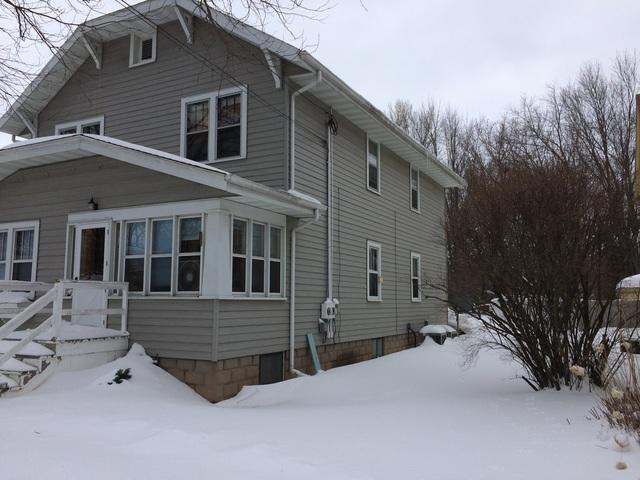 White LeafGuard Gutters Installed on a Two Story Home in Green Bay, WI