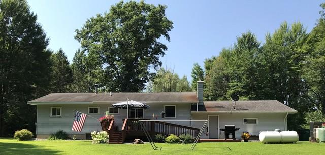 LeafGuard gutters installed on home in Pittsville, Wisconsin - Before Photo
