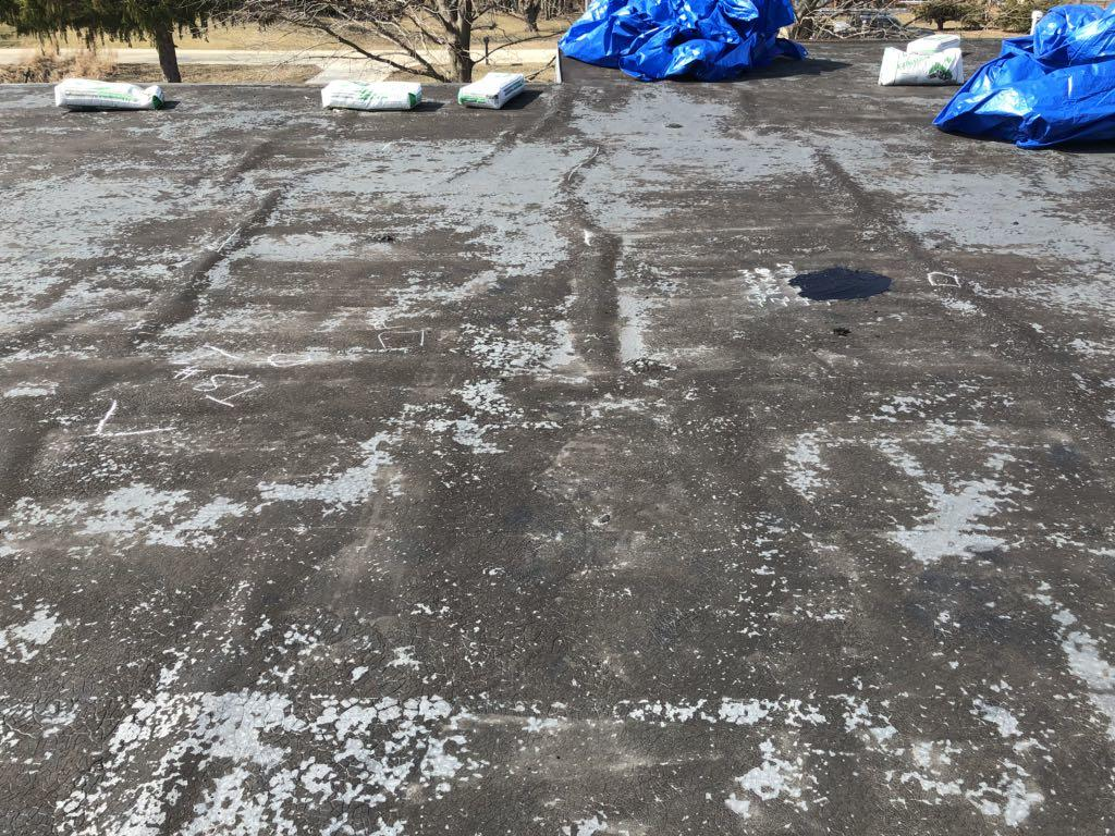 Emergency Flat Roof Replacement in Machesney Park, IL - Before Photo