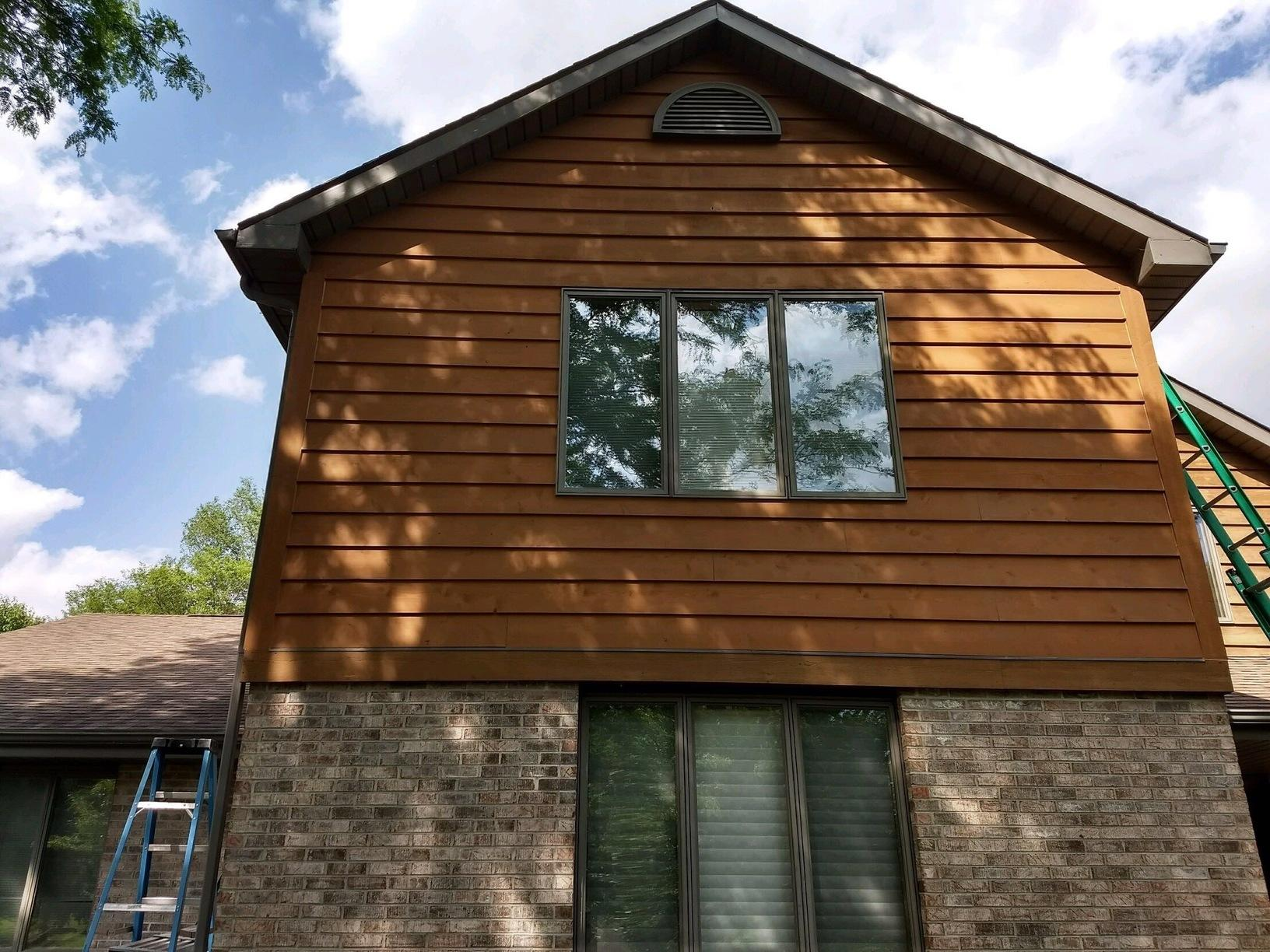 Cedar Siding Repair in Janesville, WI - After Photo