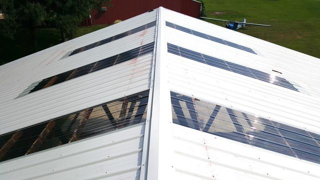Metal Roof Installation on Airplane Hanger in Rockford, IL