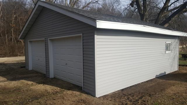 Vinyl Siding Installation and Roof Replacement in Oregon, IL - After Photo