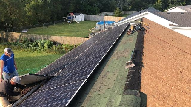 Asphalt Shingle Roof Replacement with Solar Panels in Machesney Park, IL