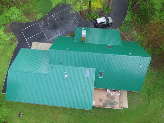 Green Metal Roof in Rockford, IL