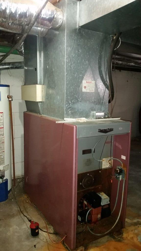 Oil to Gas Furnace Replacement in Winston Salem, NC - Before Photo