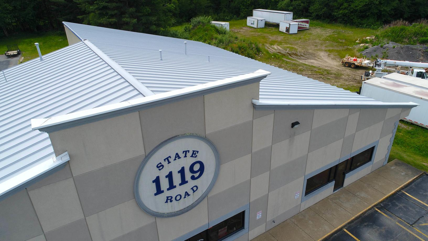 Metal roof on business in Westport, MA receives new coating of Gaco Roof sealant - After Photo
