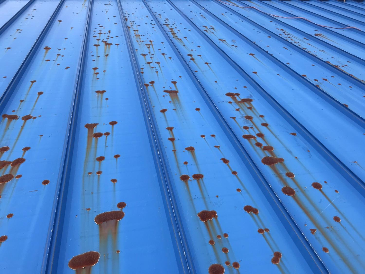 Metal roof on business in Westport, MA receives new coating of Gaco Roof sealant - Before Photo