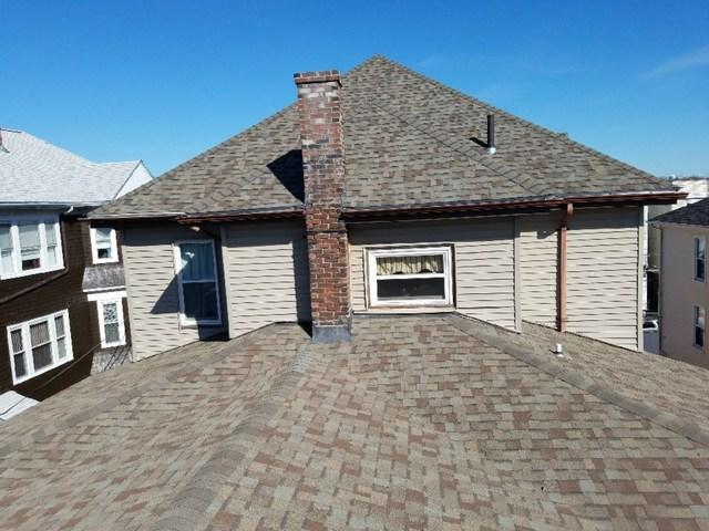 Fall River, MA 3-family home gets 50-year roof