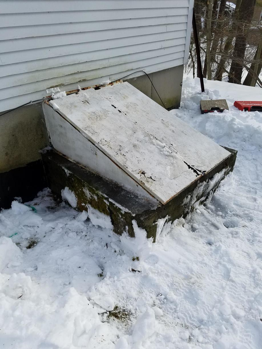 Installation of Angle Door with Foundation Plates in Bow, NH - Before Photo