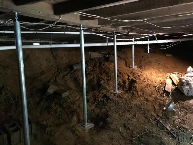 Supporting Sinking Floor from Inside Crawl Space in Spruce Pine, NC