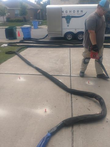 Driveway Caulked and Lifted in Bastrop, TX