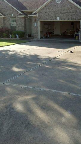 Driveway Lifted and Caulked in Round Rock, TX - Before Photo