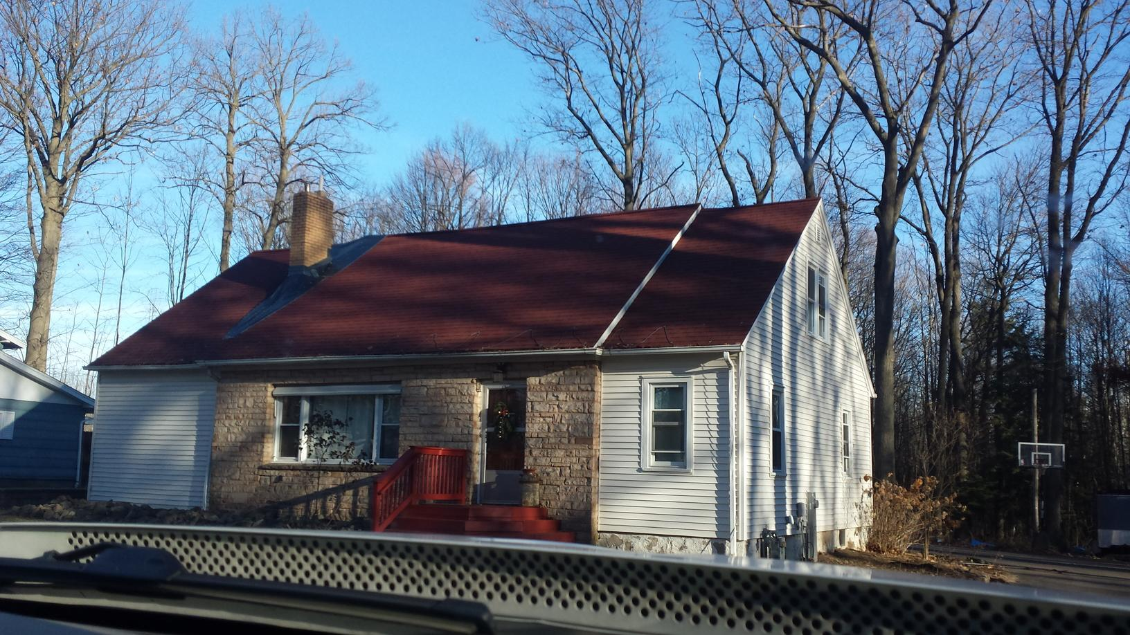 Wausau roof that was raised to provide proper ventilation - Before Photo