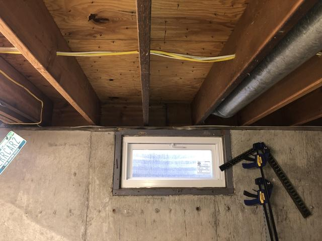 Insulating a Rim Joist with Spray Foam in Northport, NY