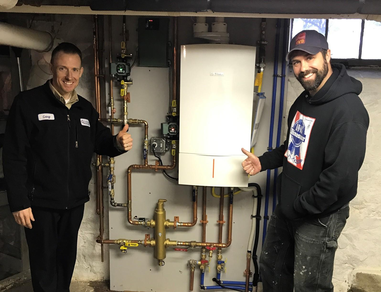 Pelletier technicians and a completed gas furnace upgrade