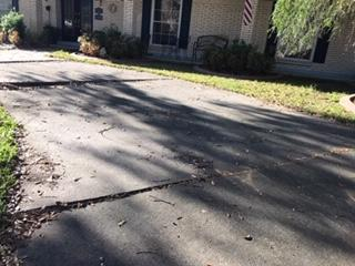 Uneven Driveway Restored in Monroe, LA - Before Photo