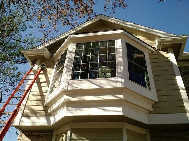 New siding, fascia, windows and gutters - After Photo