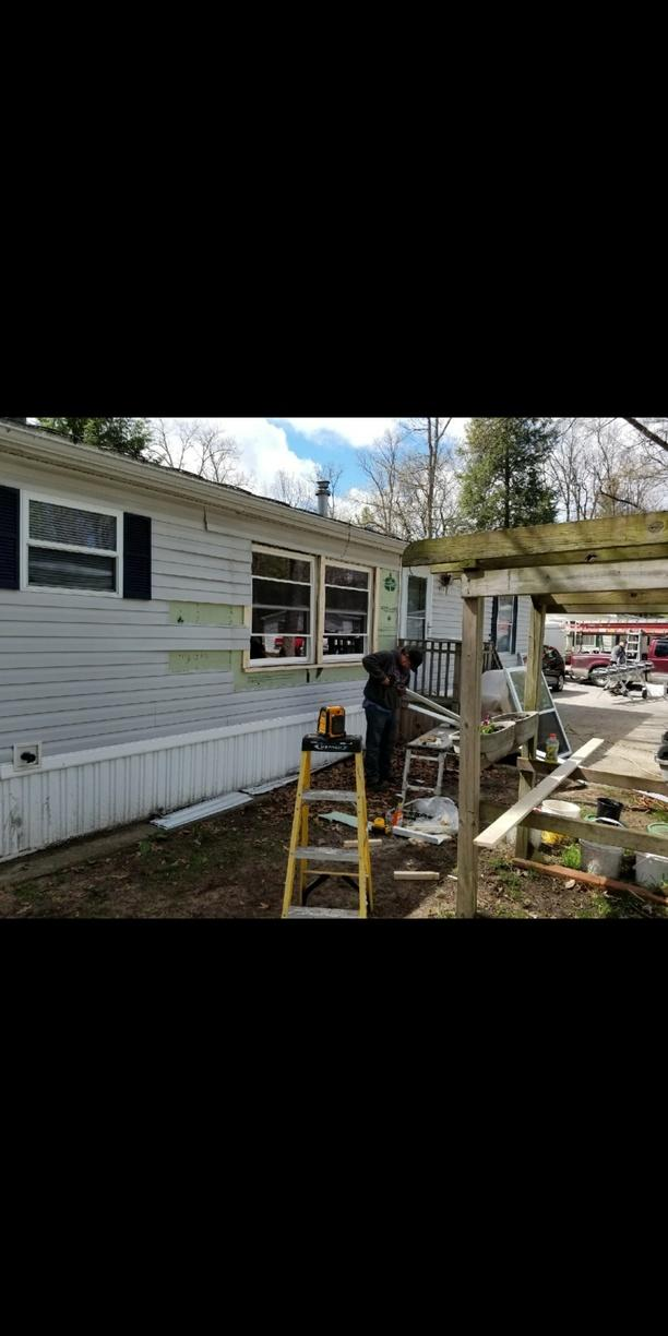 Replacing builders grade windows with our Trust Energy Efficient window in Grand Haven, MI - Before Photo