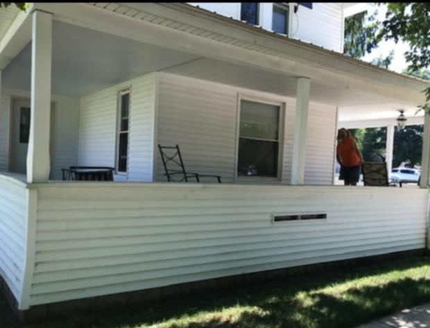 Treated wood deck in Clarksville, MI - Before Photo