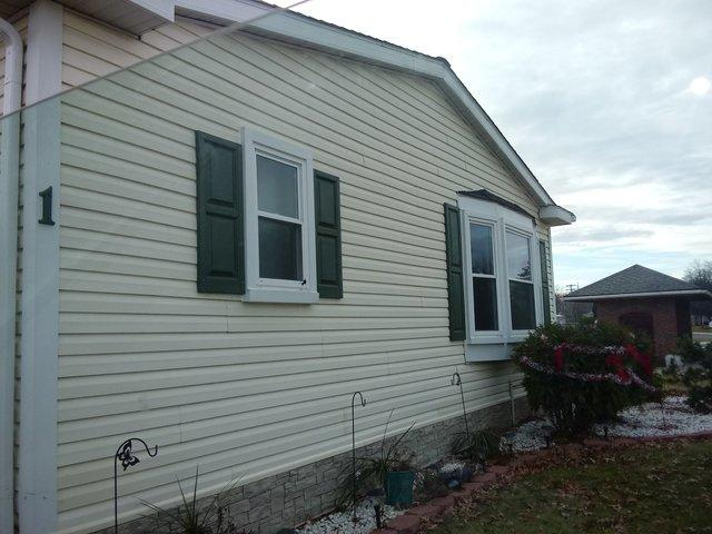 Replaced 26 year old siding - Before Photo