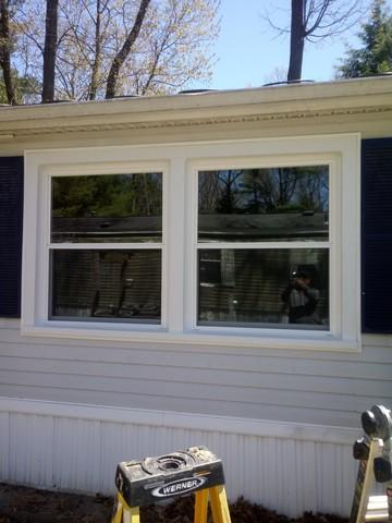 Replacing builders grade windows with our Trust Energy Efficient window in Grand Haven, MI