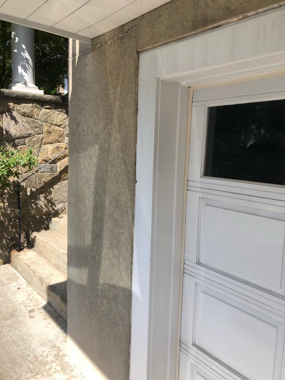 Re-caulking Garage Door in Greenwich - Before Photo