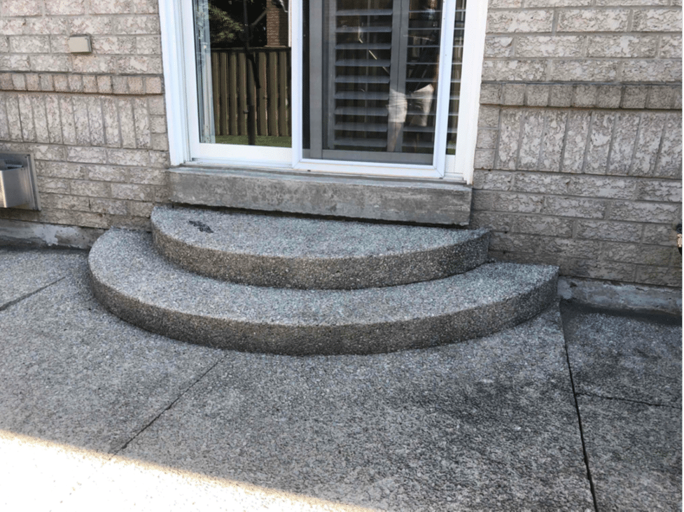 Backdoor Step Sinks and Pools Water in Mississauga, Ontario - Before Photo