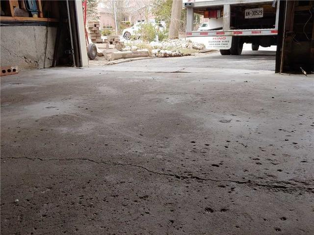 Garage Floor Cracked and Separated in Aurora, Ontario