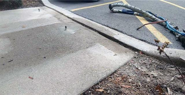 Tripping Hazard Outside of Insurance Brokerage in Burlington, Ontario - Before Photo