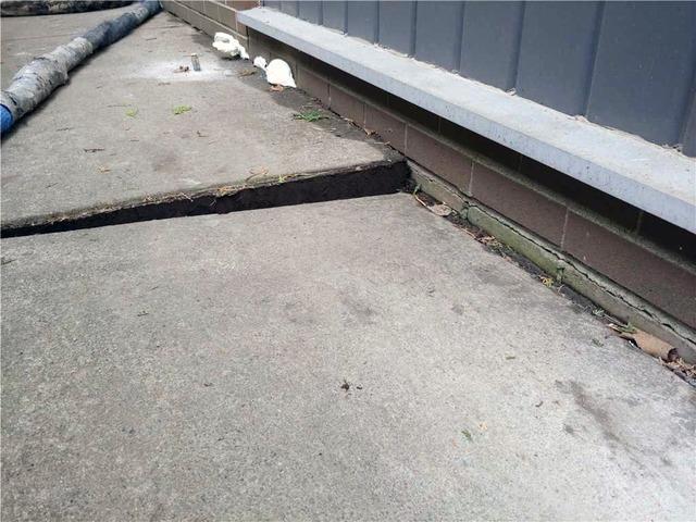 Sinking Concrete Slabs Lead to Water Seepage in Oshawa, Ontario