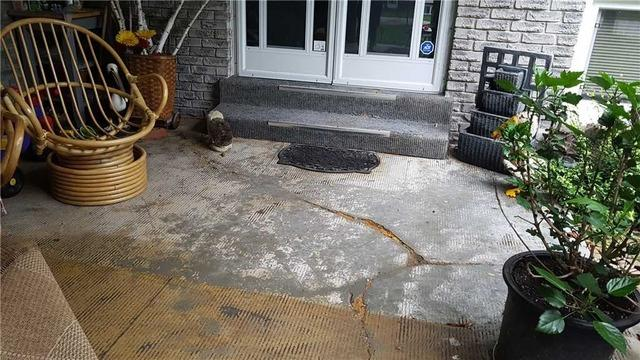 Old Carpet Hides Cracking on Front Porch in Orillia, Ontario