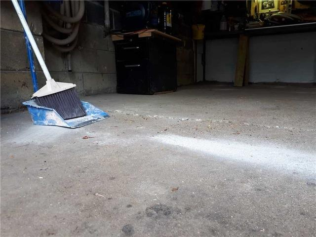 ettling Garage Floor Cracks in Mississauga, Ontario - Before Photo
