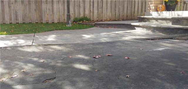 Sinking Walkway Cracks Concrete in Mississauga, Ontario