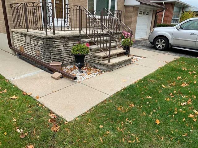 Sinking Concrete Allows Water to Threaten Home's Foundation in Etobicoke, Ontario
