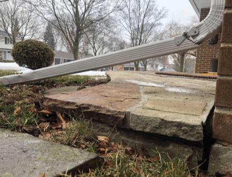 Sinking Concrete Makes Mail Runs Dangerous in Toronto, Ontario