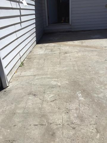 Sinking Back Patio Creates Patch of Ice in Orillia, Ontario