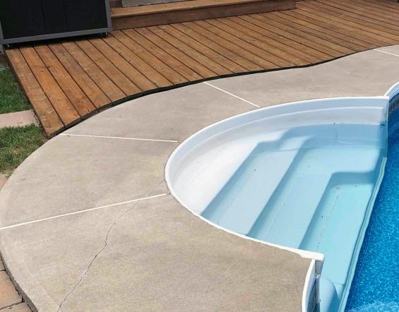 Concrete Pool Deck Sinks Away from Wooden Patio in Whitby, Ontario