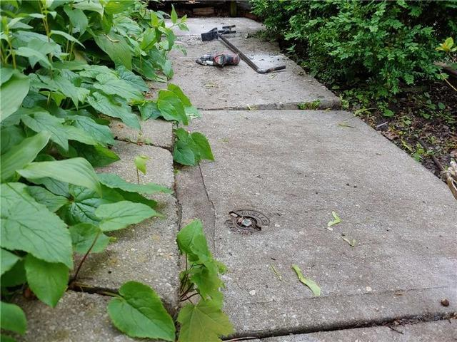 Front Walkway Threatens Visitor Safety in Toronto, Ontario
