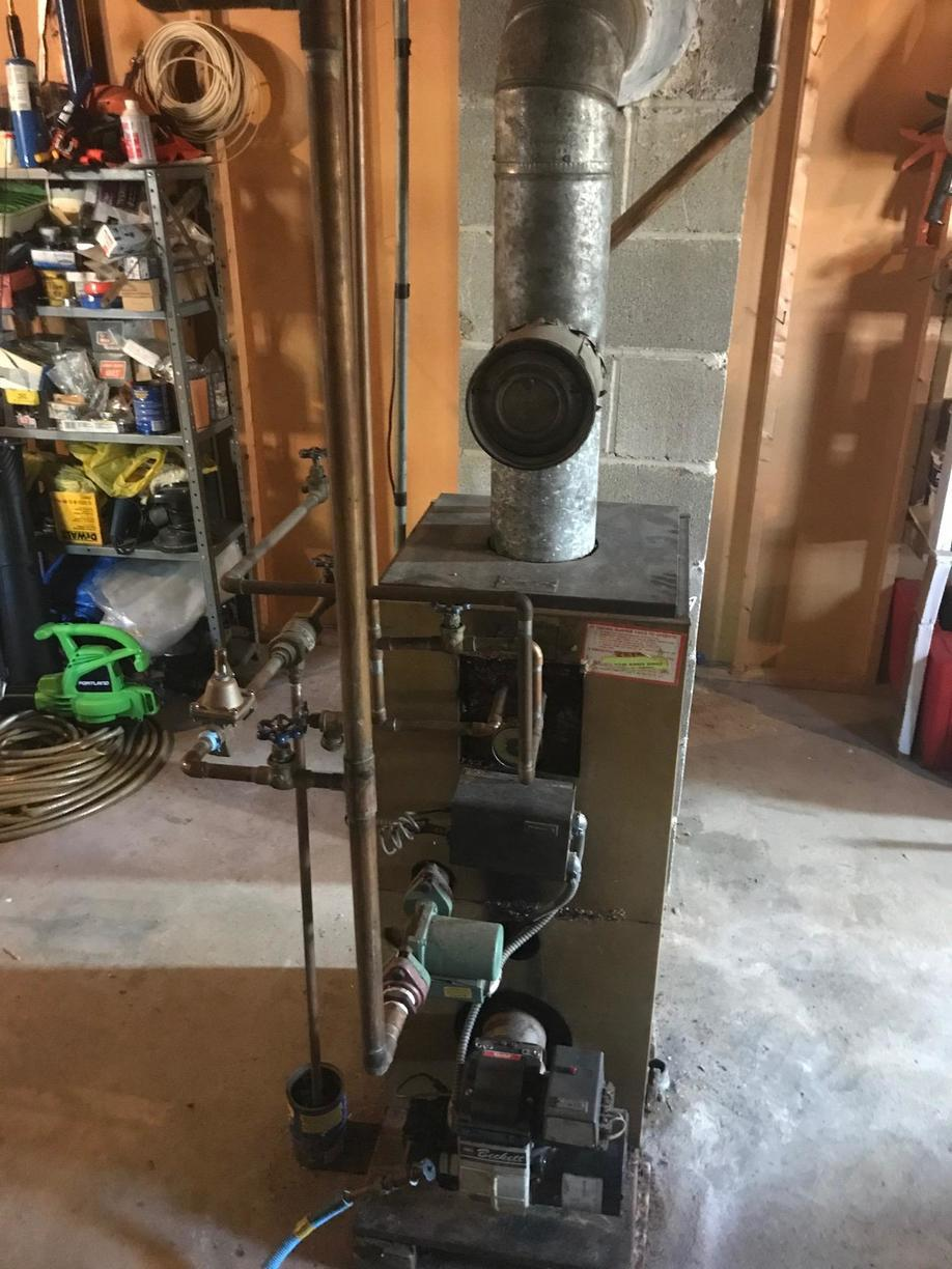 Oil to Gas conversion with Navien wall hung combi boiler in Milford, CT! - Before Photo