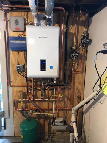 Before and after oil to gas boiler installation in Westbrook, CT