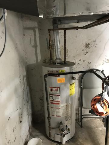 Installation of a gas hot water heater to a tankless hot water heater in Branford, CT!