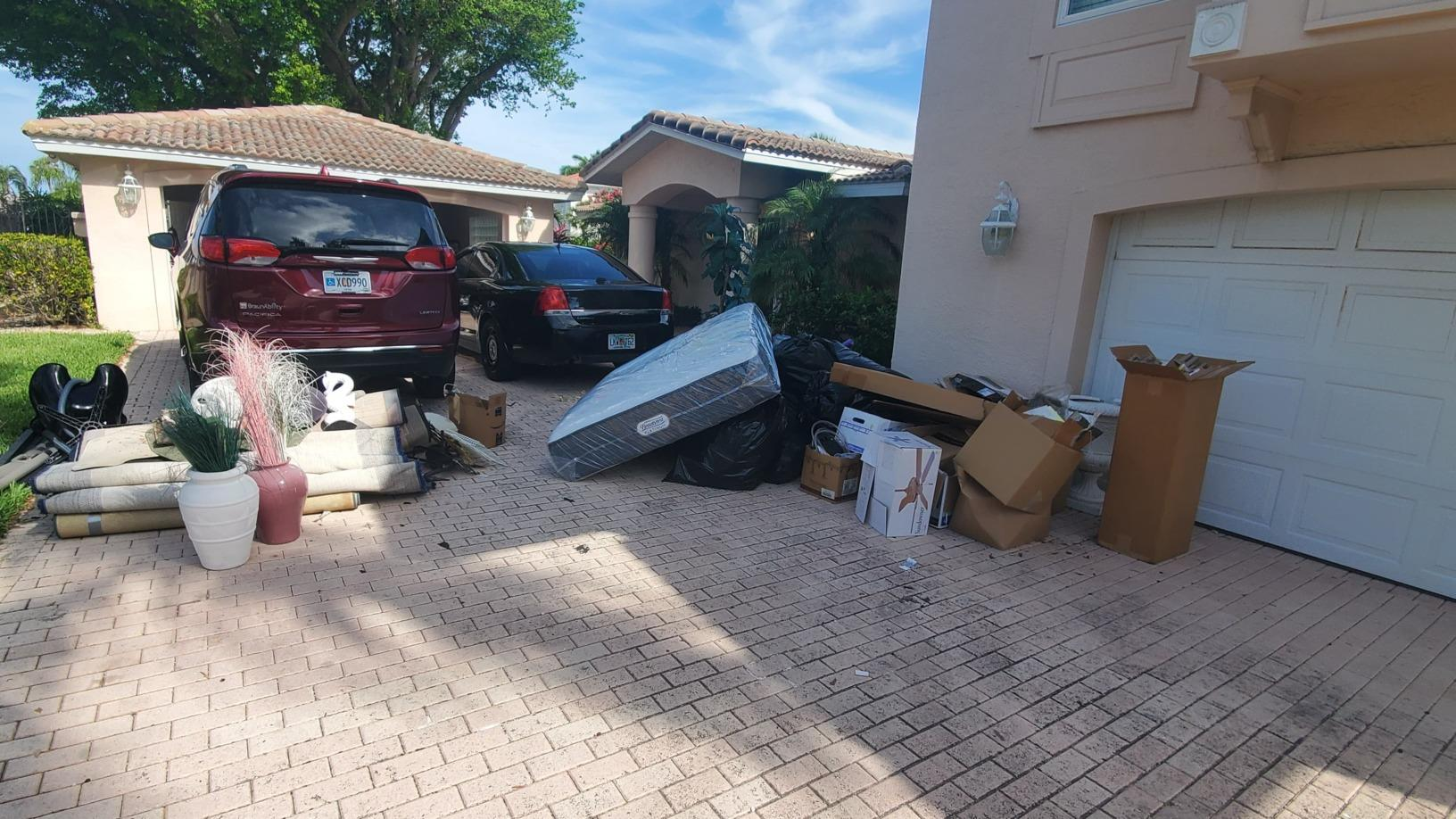 Decluttering home after contractor work in Longboat Key, FL - Before Photo