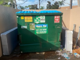 Dumpster Corral Cleanup at Property - Before Photo