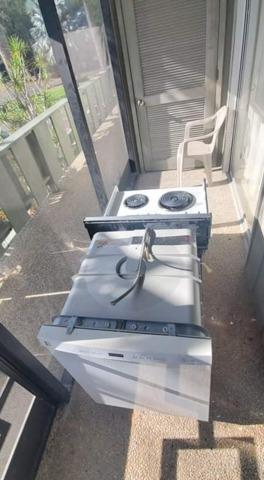 Old Stove Removal from Condominium in Holmes Beach, FL