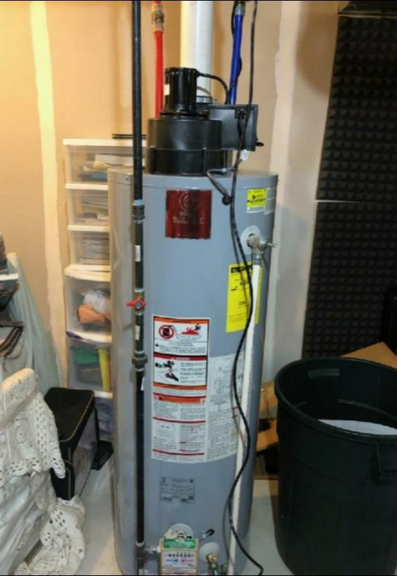 Power vent water heater installation in Mechanicville - Before Photo