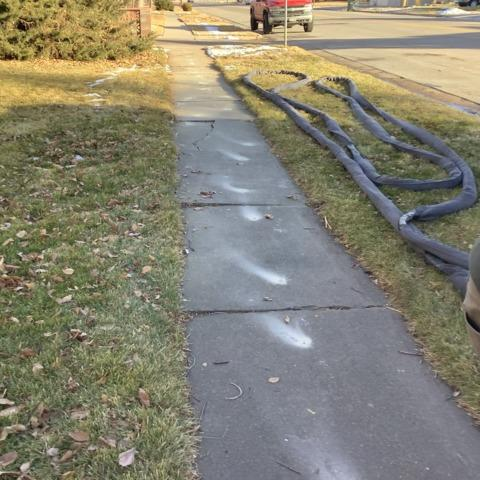 Repaired sinking sidewalk in Sterling, CO - Before Photo