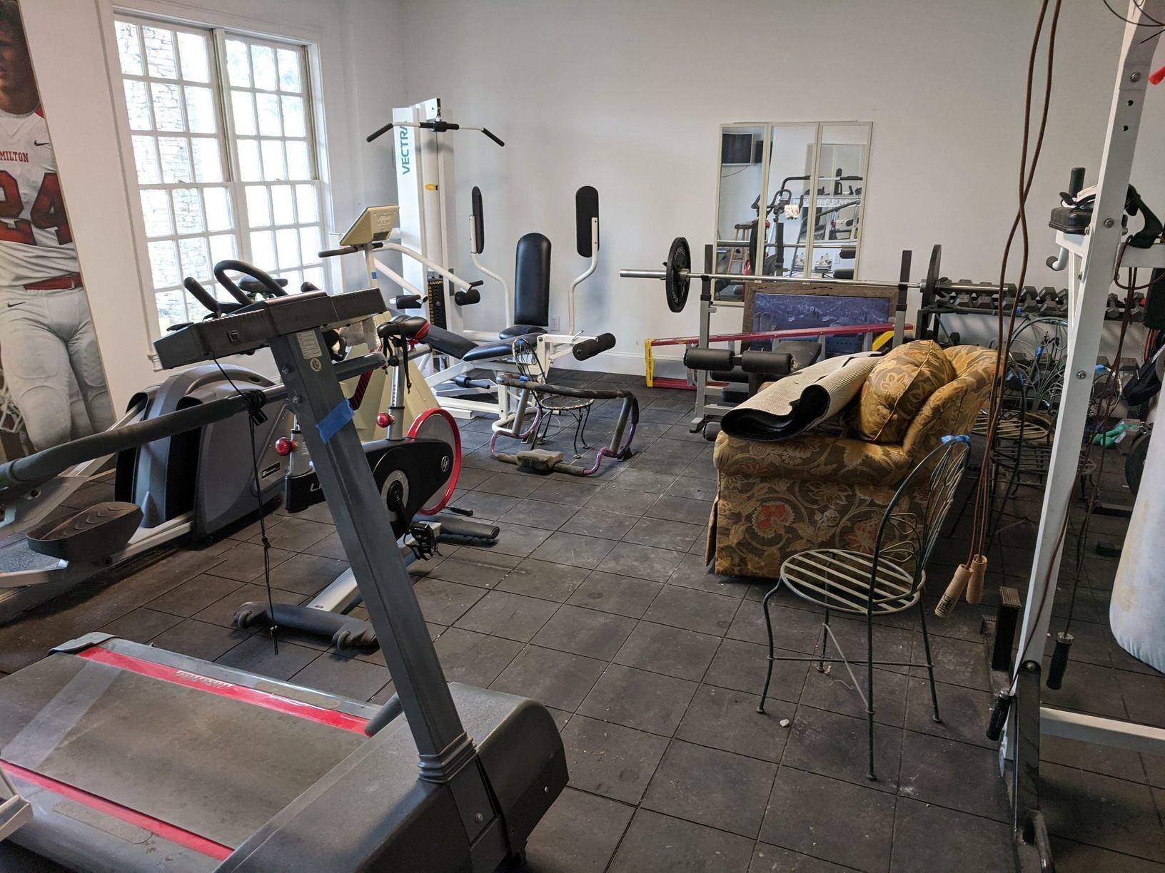 Exercise Equipment Removal in Alpharetta, GA - Before Photo